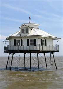 Definitely waterfront property - fishing, swimming, boating, tanning - again the best part ... no homeowners association - Middle Bay Lighthouse in Mobile, Alabama