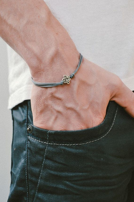Infinity bracelet for men - cord bracelet with a silver tone infinity charm (endless knot, celtic knot). The cord is gray and made of wax and the