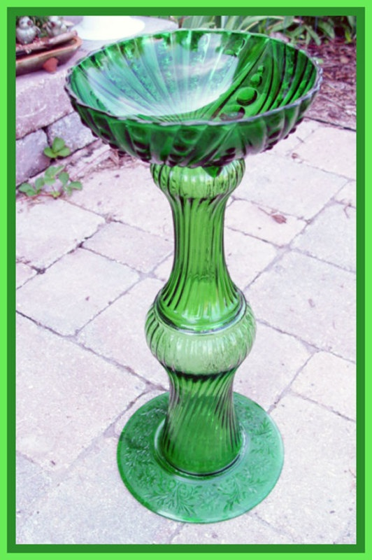 One of a Kind All GLASS Pedestal BIRDBATH. Contructed with vintage glass pieces. this was an ebay item and although the bidding is over, the image is still up and you can scroll down to see several closeup's of this for great detail.. gorgeous piece of work.