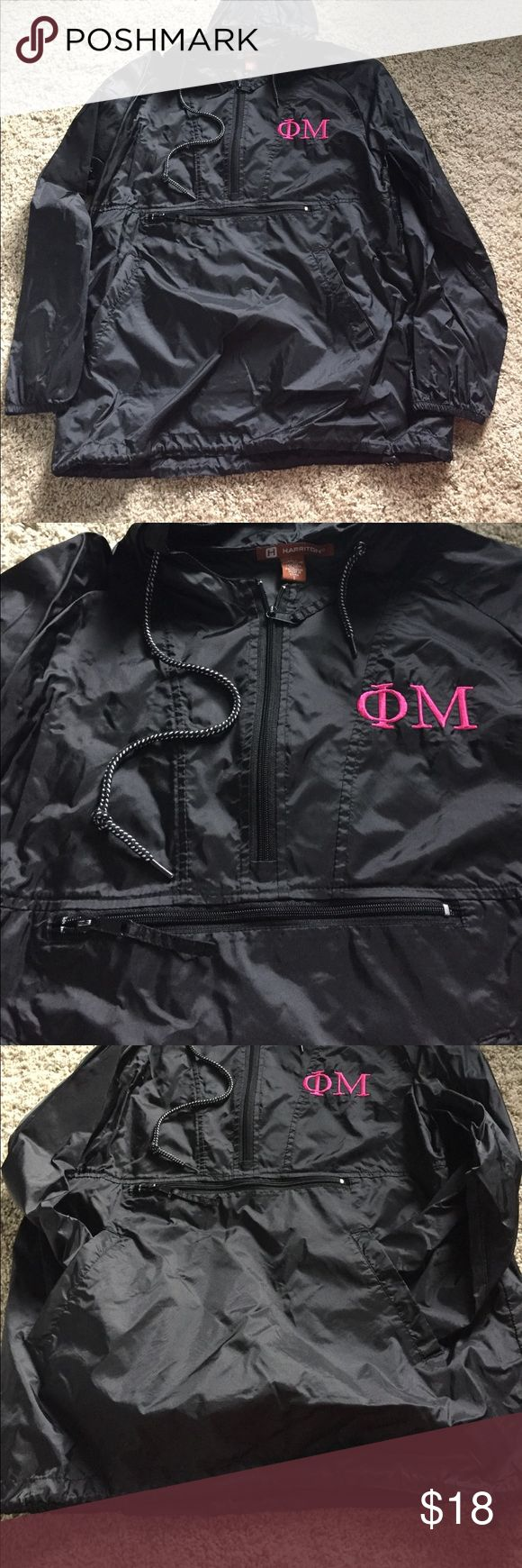 Phi Mu rain jacket/windbreaker 💖 Adorable black rain jacket with the Phi Mu letters embroidered on the chest. Quarter zip and large zipper pocket across the front. Also has hand pockets, a hood, and adjustable waistband. NWOT Size Small but has an oversized fit. Perfect for big/little baskets!!! 💖 Jackets & Coats