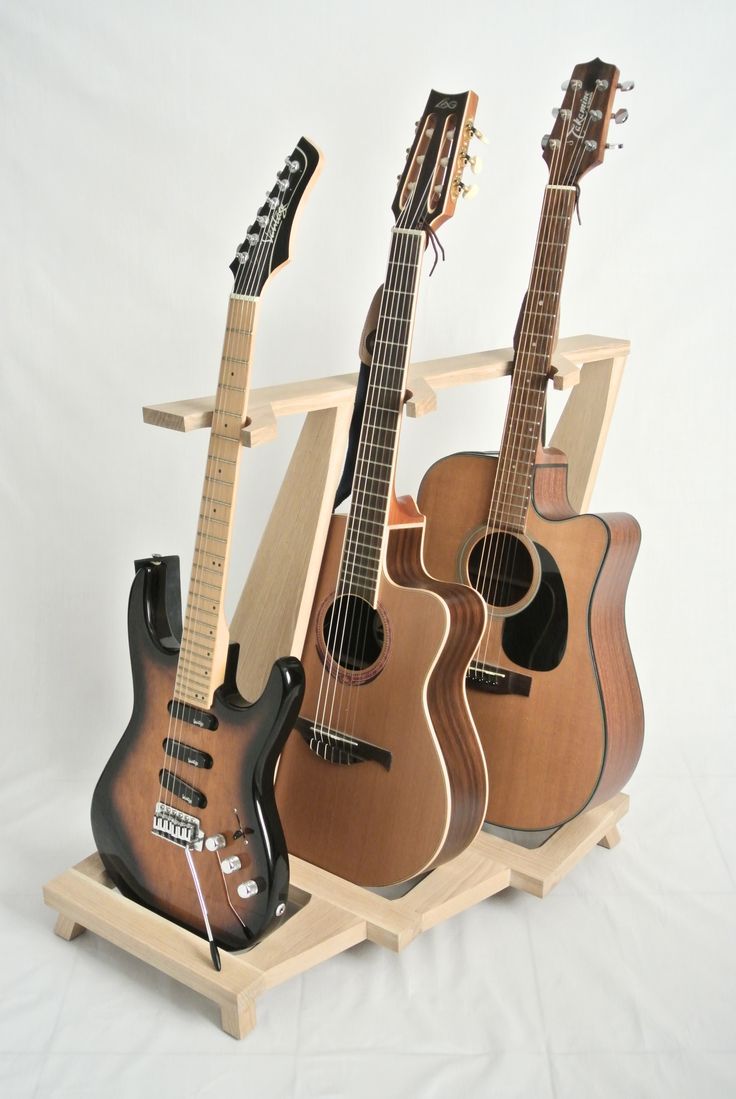Guitar stand made of wood with three guitars must make