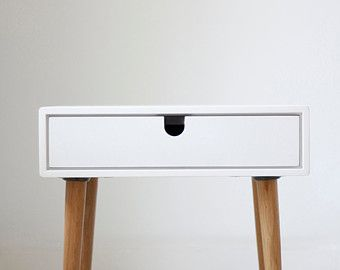 Beautiful Nightstand / bedside table inspired by Scandinavian mid-century design.  Fully handmade with high quality materials. This new version has gained in height thanks to the design of new legs that are taller and stylized. measurements: Table 2 drawers - 18.3 wide x 13.77 deep x 23.03 high (46,5 cm wide x 35 cm deep x 58.5 cm high) Table 1 drawer - 18.3 wide x 13.77 deep x 19.48 high (46,5 cm wide x 35 cm deep x 49.5 cm high) body / frame  Solid oak board in high resistance whi...