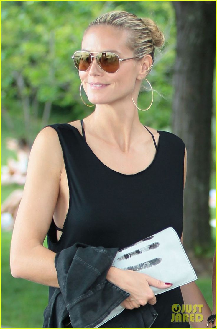 Heidi Klum - messy bun, great shades and earrings, simple tank....love it.