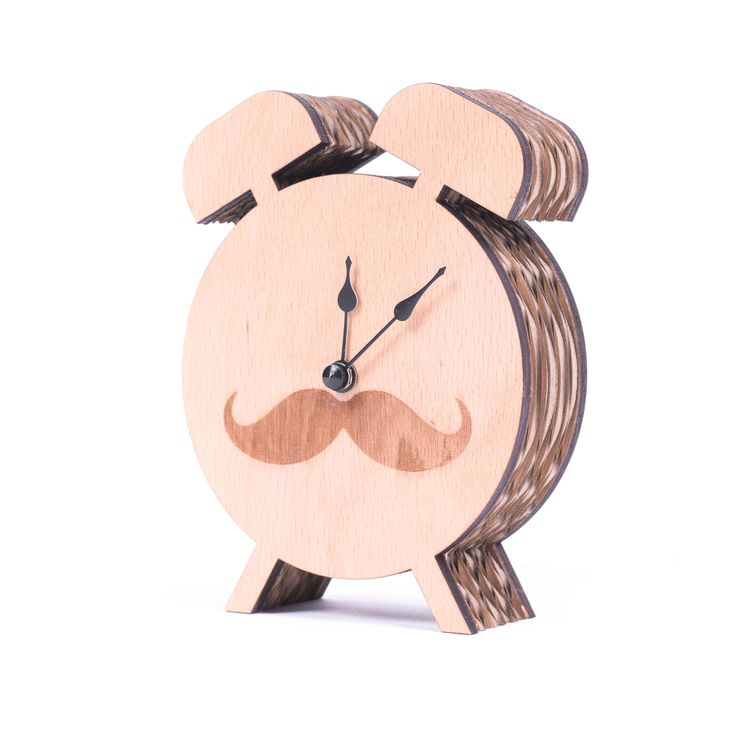 Cute Kartoons clock in the shape of an alarm clock will not disturb your sleep. It doesn't ring. The clock is, however, fully functional. It is powered by a reliable Quartz clockwork. You can choose from alarm clocks with a neatly combed mustache or a pictured clock face. We will wrap the cardboard alarm clock in a stylish gift-box that will definitely please as much as the clock itself.