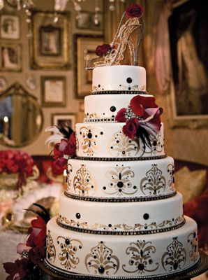 Moulin Rouge inspired wedding cake - gold, black, and silver flourishes grace the sides of the cake topped with a vintage glass heel. Cake by Nancy Kay's Confections.