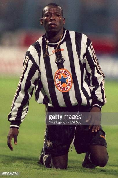 Faustino Asprilla of Newcastle United on his knees