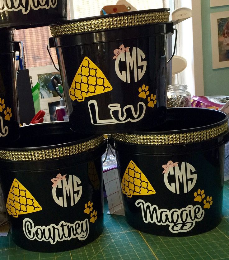 Personalized monogrammed cheer buckets to put all the cheer camp goodies/gifts in