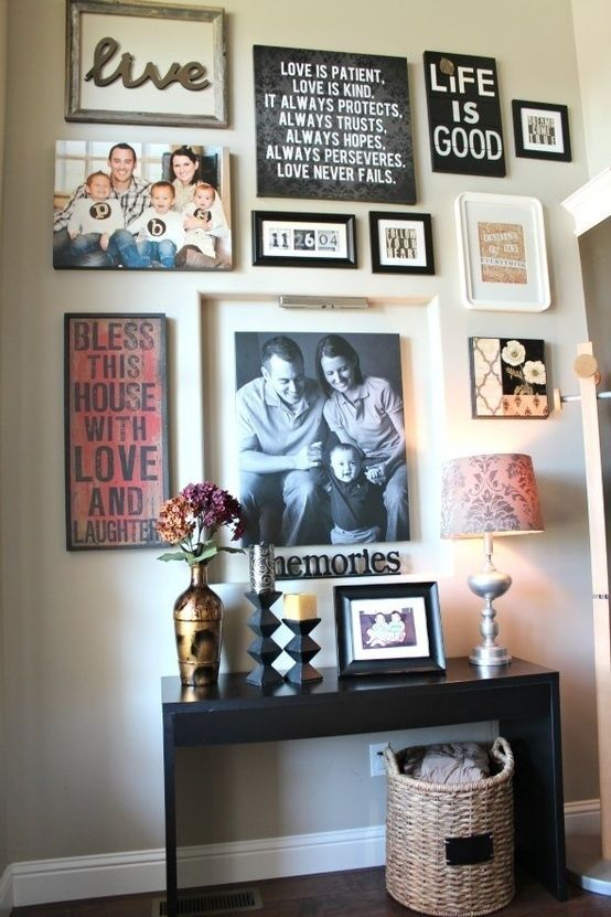 Love the mix of quotes, the frame with a word in it, and photos in this gallery wall | fabuloushomeblog....