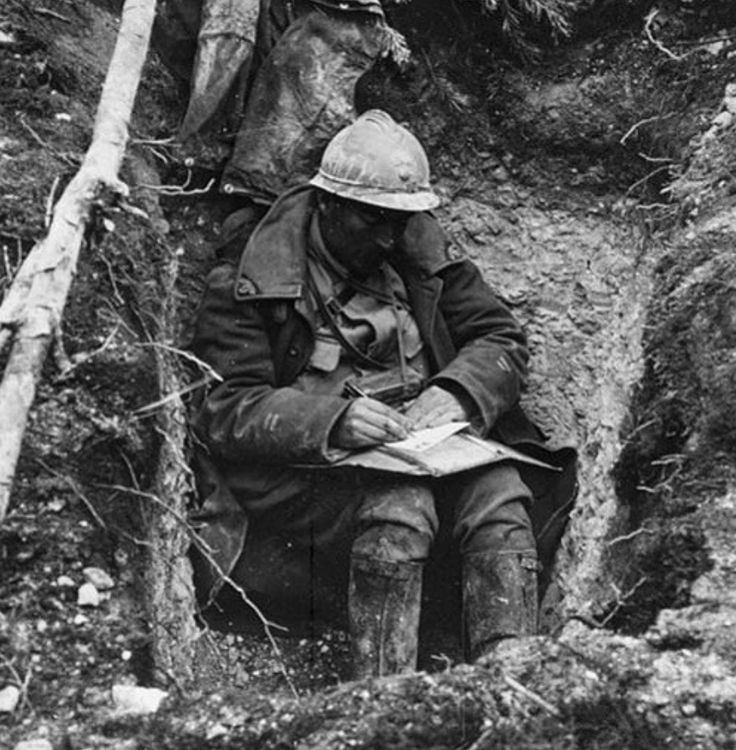 Unknown soldier writing/reading during the Battle of Verdun - 1916