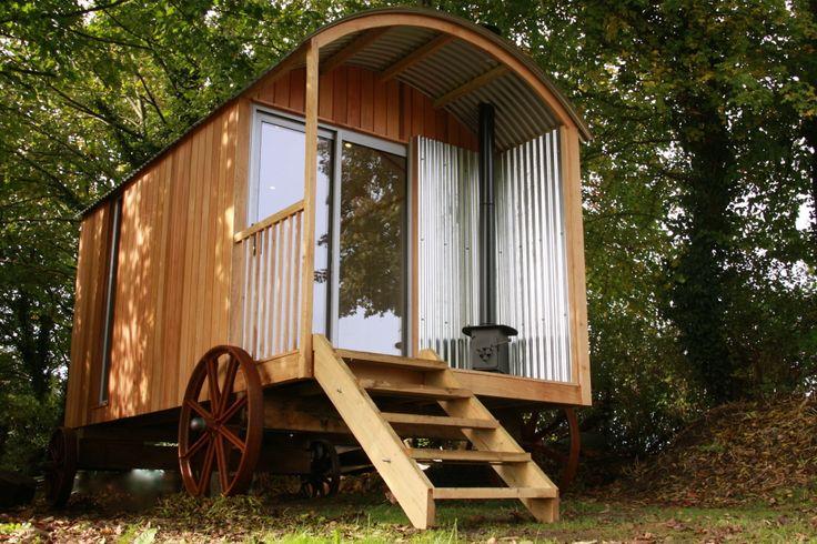 Shepherds hut with cedar cladding and veranda.