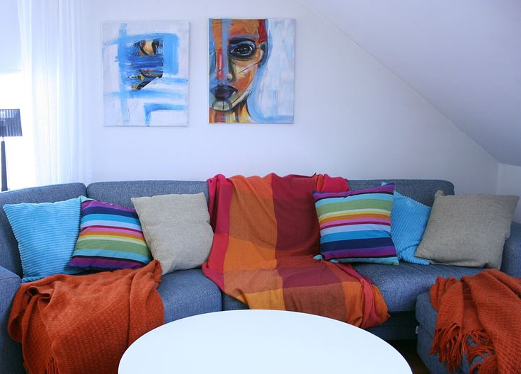 Livingroom. Always hated this blue horse-big sofa but started to cover it with plankets... for some reason.