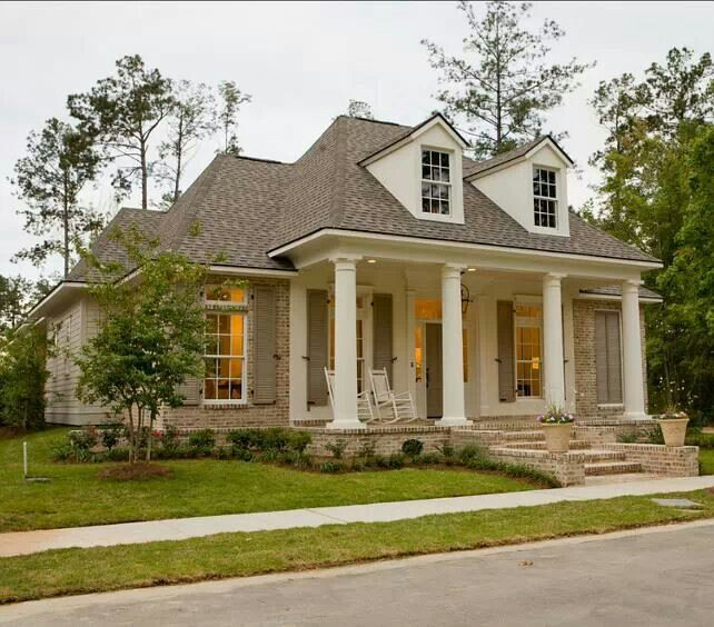 Love the Louisiana style house! Hey, this is almost exactly like my house... give it black shutters and a red door!