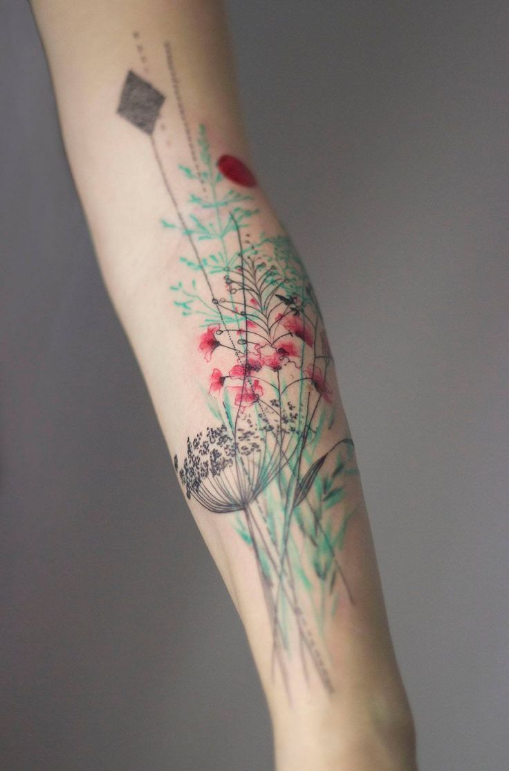 Pastel Colored Flowers Arm Tattoo