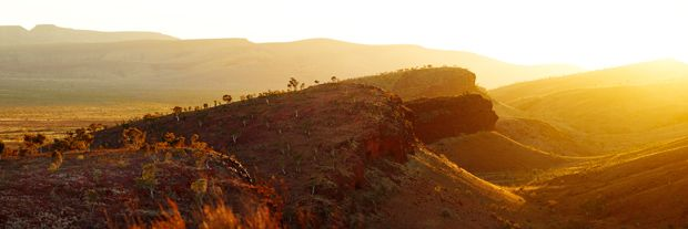 The photographer described this early morning scene as 'a secret location just out of Tom Price.' Tom Price is an established iron ore mining community in the interior of the Pilbara and this 'secret location' is part of the undulating Hamersley Ranges. The Pilbara's inland is dominated by cascading, dramatic ranges like this and has long inspired photographers and artists.
