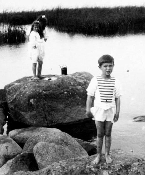The tsarevich with his sisters Anastasia and Maria at the beach c. 1909. You can see the bruises from hemophilia on his legs.