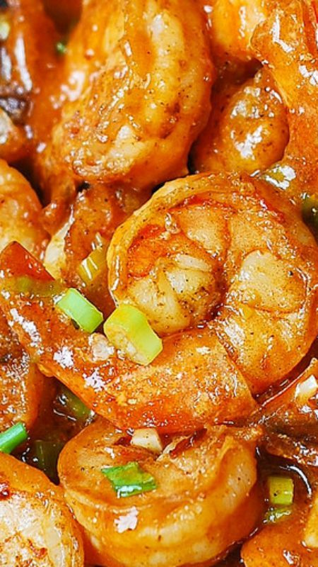 Easy Spicy Cajun Shrimp (with sauce) ~ Delicious Southern appetizer... Made with garlic, ketchup, chicken broth, hot sauce, Cajun spice, and green onions.  Super easy to make – 30 minutes from start to finish!