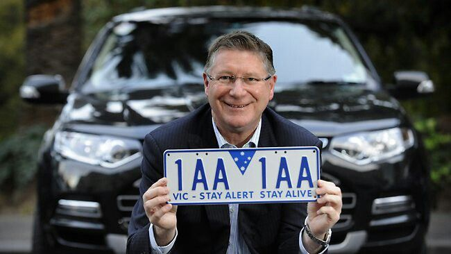 Premier Denis Napthine with one of the state's new number plates and its safety message.