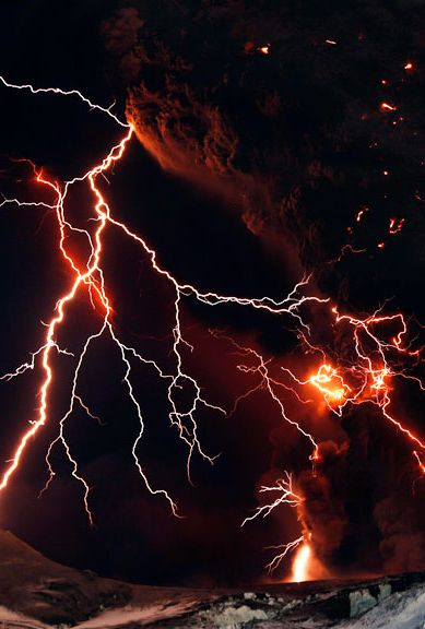 Lightning streaks across the sky as lava flows from a volcano in Eyjafjallajokul April 17, 2010. Credit:LUCAS JACKSON