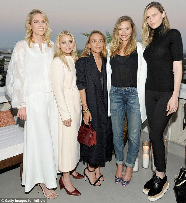 Even more sisters! The three ladies also stopped to take a shot with siblings Erin and Sara Foster