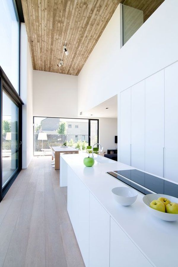 The wooden ceiling is an unexpected detail designed to balance out the whiteness