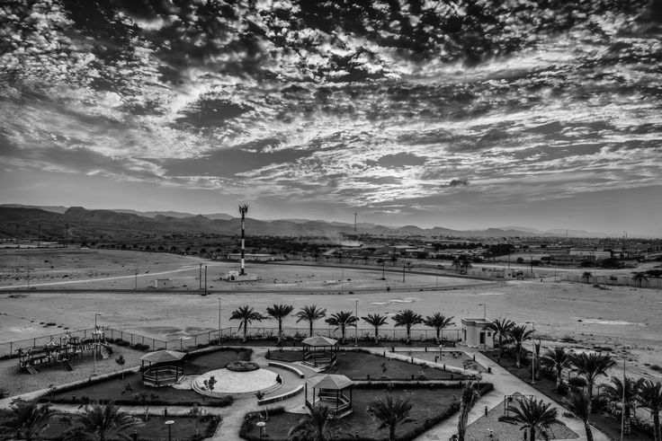 Desert Playground Contrasts - A fine evening of clouds and warm light over a playground in the desert :)  http://macmatt78.wixsite.com/mattmacdonaldphoto