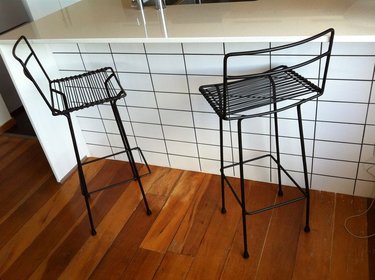I found these old metal and cane chairs second hand in a dilapidated state and sprayed them black then made the seats out of black venetian blind chord