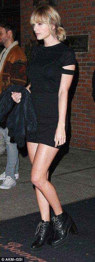 She's got it going on: Taylor looked stunning in her super sexy mini and chunky lace-up boots for her outing