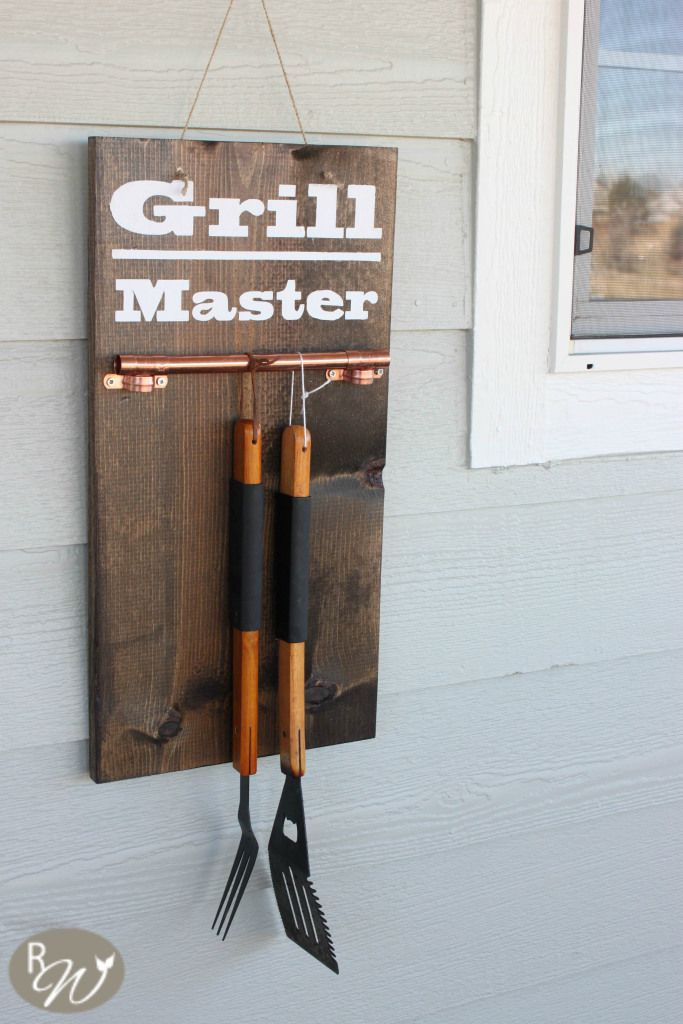 DIY hanging grill tool display sign is made of wood, stain and copper pipe. It's a gift Catherine Elsby of The Rustic Willow made for her husband. See the tutorial on her blog.    @therusticwillow