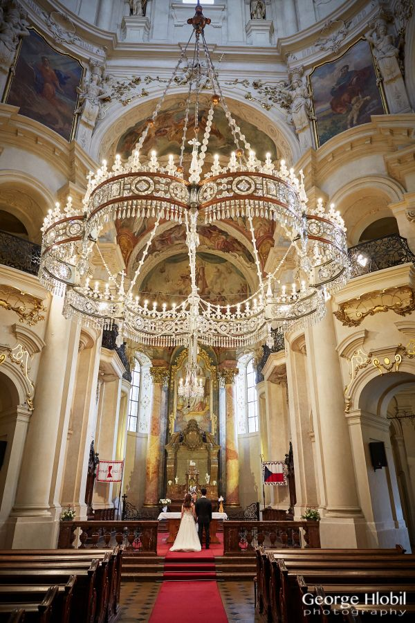 Wedding vows renewal ceremony at beautiful St.Nicholas church in Prague Old Town