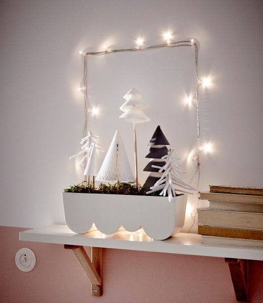 IKEA ÄGGPLANTA planter placed on a shelf is filled with moss and paper trees to create a winter landscape decoration.