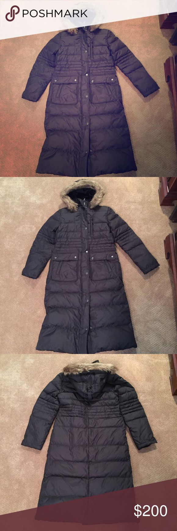 NWOT DKNY Long Puffer Coat with Faux Fur Hood NWOT DKNY long puffer coat with Faux fur hood. Size medium. Dual zipper with snaps. Zippers on the bottom on each side of coat. Front has two large snap pockets and one of the snap pockets has an open pocket on top. Zipper pocket on left breast. Two zipper pockets inside coat. Top half of coat and inside of hood lined with Faux fur. Tags removed but never worn. From a smoke-free home. DKNY Jackets & Coats Puffers