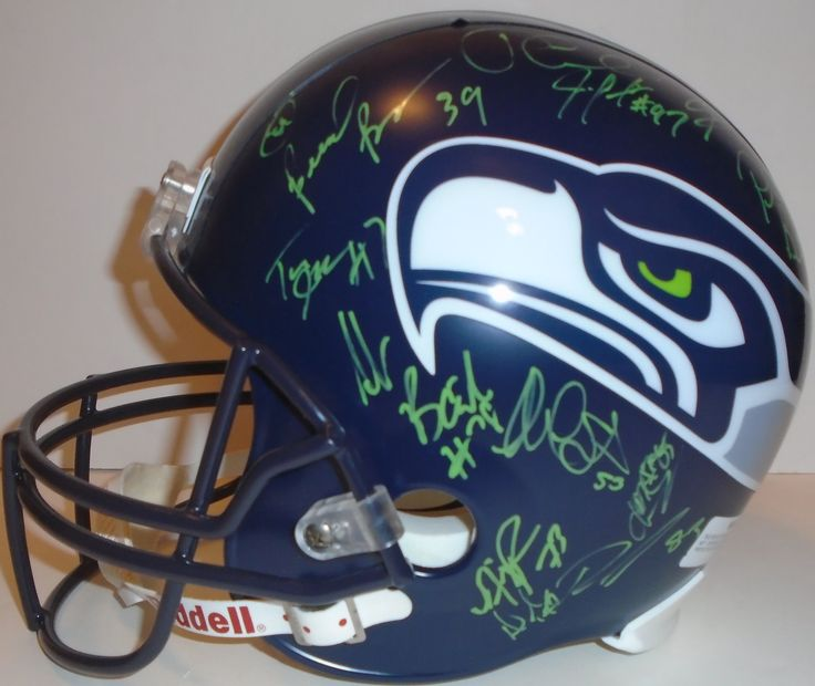 SOLD OUT! 2013 Seattle Seahawks team signed Riddell full size football helmet w/ proof photo.  Proof photo of the Seahawks signing will be included with your purchase along with a COA issued from Southwestconnection-Memorabilia, guaranteeing the item to pass authentication services from PSA/DNA or JSA. Free USPS shipping. www.AutographedwithProof.com is your one stop for autographed collectibles from Seattle sports teams. Check back with us often, as we are always obtaining new items.