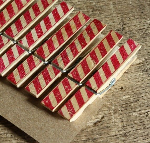 cute idea--candy-striped clothes pins to hang Christmas cards (using a red Sharpie)