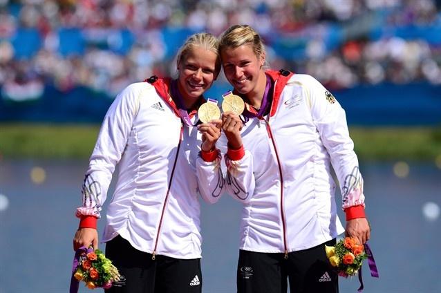 Franziska Weber and Tina Dietze of Germany celebrate winning gold in women's K-2 500m