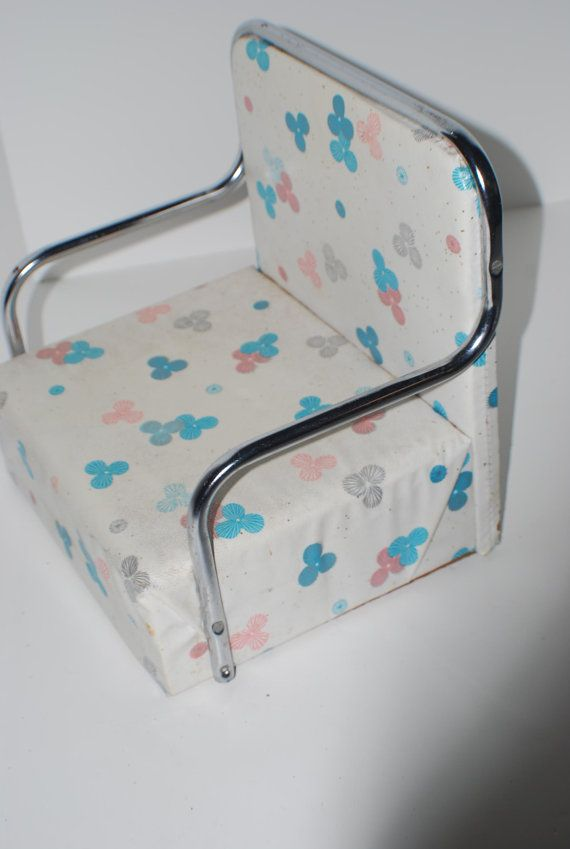 50's or 60's child booster chair; it had a strap to attach it to the chair (not the child).