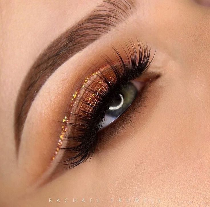 Cut crease in copper: brown shadow in the crease with glitter liner and foiled copper shimmer on the lid. Perfect makeup look for brown or hazel eyes. This makeup look would look good for prom or homecoming.