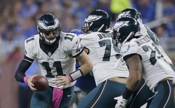 Eagles vs. Lions:  24-23, Lions, October 9, 2016  -        Philadelphia Eagles quarterback Carson Wentz hands off during the first half of an NFL football game against the Detroit Lions, Sunday, Oct. 9, 2016, in Detroit. (AP Photo|Duane Burleson)