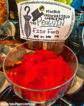 Penguin Fish Food. Batman Birthday Party Ideas. Superhero Birthday Party. Food, Decorations, and Fun. The Joker, Harley Quinn, Superman, Justice League, Suicide Squad, and more!