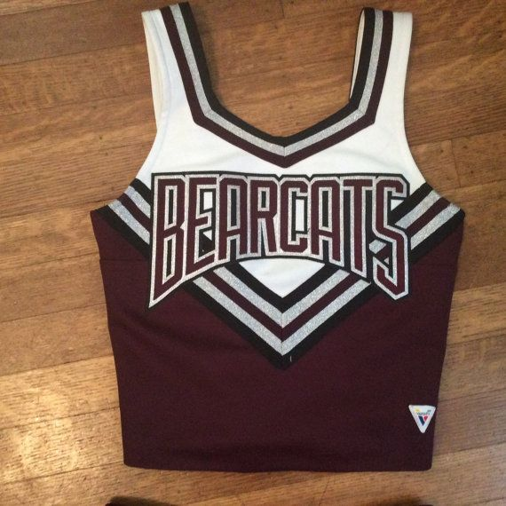 This cute cheerleading uniform is in very good vintage condition. There are no stains, holes or snags. However, there is a slight color variation between the skirt and the shirt (see photographs). Top: Size 34, with adjustable straps. Measurements laid flat: Shoulder to shoulder - 11 Armpit to armpit - 14 1/2 Waist - 13 Skirt (closes with a zipper and 2 adjustable buttons): Waist - 13 Length (waist to hem) - 15 Shipping within the United States will be via USPS Priority Mail, which usua...
