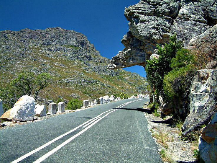 An overhanging rock in the Bain's Kloof Pass where large trucks cannot pass under. Near Wellington, South Africa.