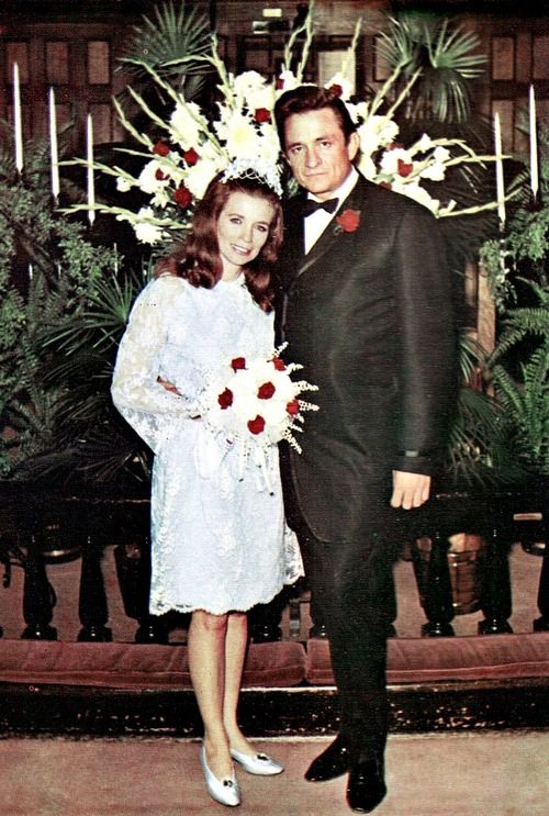 """Johnny Cash and June Carter on their wedding day, March 1, 1968. Their marriage lasted 35 years. When June died in 2003, Johnny was devastated. At her funeral, Johnny had to be helped from his wheelchair to view his wife's face one last time. At a family gathering, he said, """"I don't know hardly what to say tonight about being up here without her. The pain is so severe; there is no way of describing it."""" Johnny Cash died less than four months later."""
