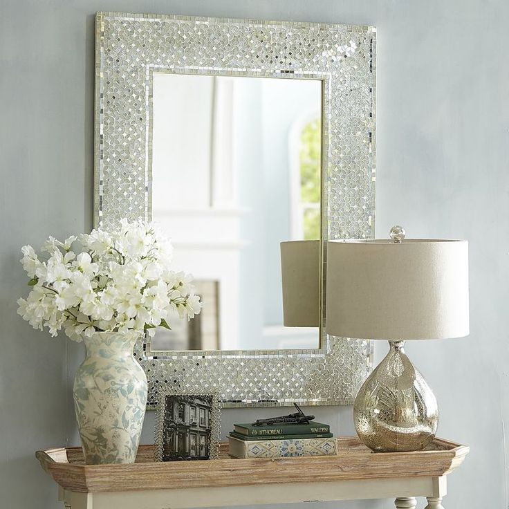 Mirror, mirror on the wall, who has the coolest decor of all? You will, when you hang our handcrafted mirror. Tiny, shimmering pieces of glass create a rippling, sparkly design and add to the shine factor of this lovely reflective piece.