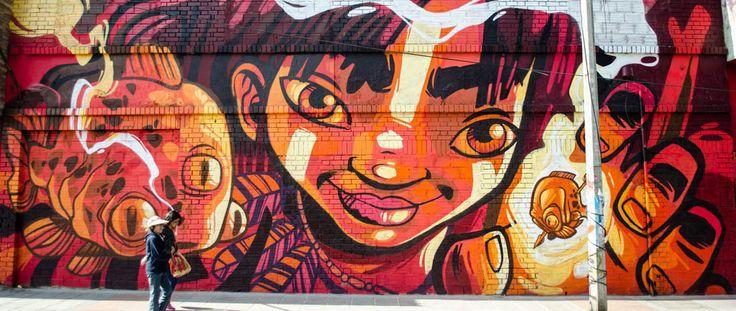 El arte urbano revitaliza el barrio Santa Fé vía cartelurbano