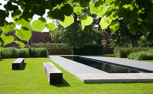 A pool made for swimming lengths. Love how the pool benches reflect the shape of the pool.