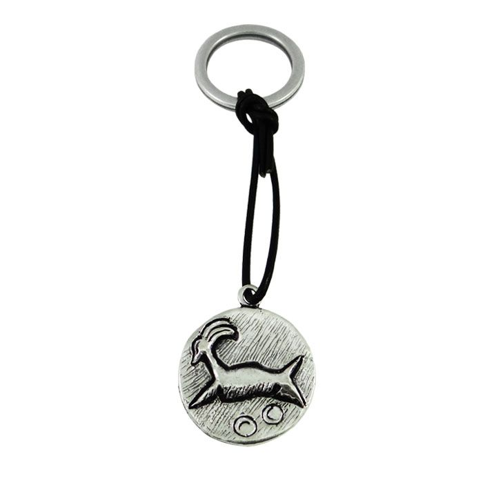 Key-ring with a signet seal, depicting a ram (aigagros). The round seal is a finding of the Pre-palatial Minoan Civilization from Phaistos. 2200-2000 B.C., Crete Diameter of signet: 2,7cm x 3 mm Dimensions of key-ring: 2,7cm x 10cm x 3 mm Silver-plated bronze, attached with black leather on the ring.