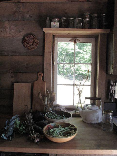 cabin kitchen..storage over windows..every little bit counts
