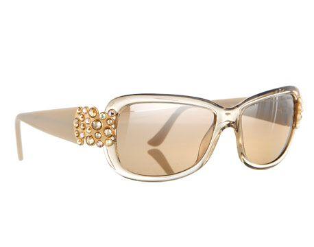Swarovski Sunglasses  Swarovski sunglasses with 24k-gold and crystal detail ($950), daniel-swarovski.com