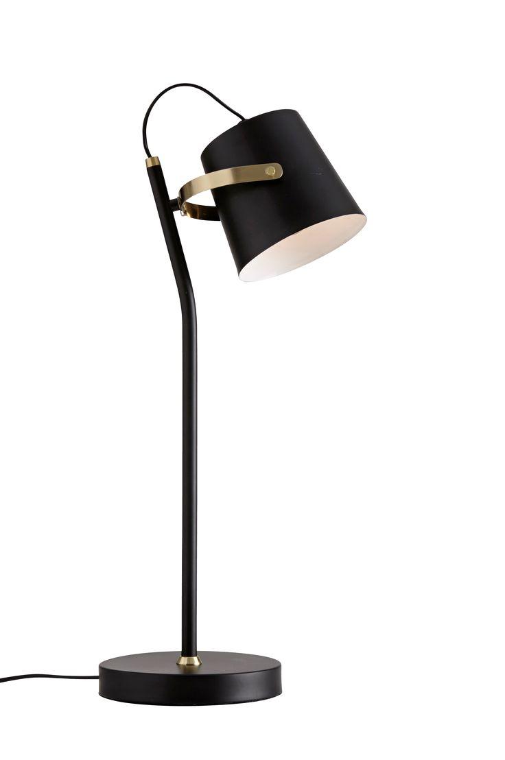 Bordslampa av mattmålad metall med mässingsfärgade detaljer. Skärmen är justerbar i sid- och höjdled. Lampans höjd 57 cm. Skärmens höjd 13 cm, Ø 14 cm. Sladd med strömbrytare, sladdlängd 1,5 m. Liten sockel E14. Max 40 W. Ljuskälla ingår ej.