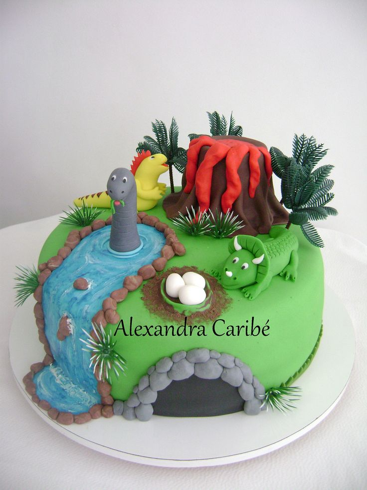 Dinosaurs Cake. This looks like what my son is describing for his 5th birthfday cake