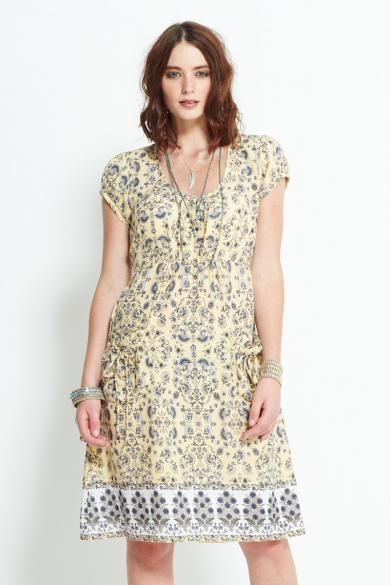 Shortsleeve Pocket Dress in a soft border print in sunshine yellow. Lovely details, gathered pockets, pretty buttons and tie backs. Perfect to layer with our coordinating summer knitwear.